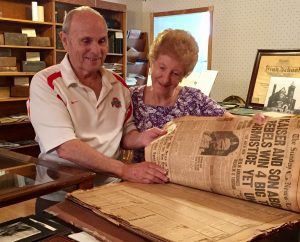 Jim and Betty Castellucci are shown taking a peek at some century-old newspapers in preparation for the Malvern Historical Society's premier of the Frank L. Craig Legacy Series which will debut on Saturday, August 19, 2017. The Castelluccis have their tickets for the event...have you picked up yours😀?