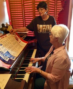 Malvern Historical Society Treasurer Linda Byrd (seated at piano) will be treating guests to live 1940's and 50's music at the keyboard. Society Secretary Sonia Strock is pictured looking on.
