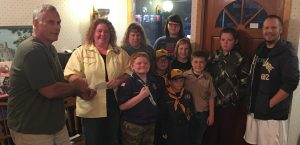 Scouts presenting donation check.